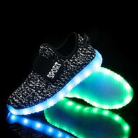 Wholesale 2017 new LED light shoes New pattern Flying yarn knitted coconut shoes Tennis USB rechargeable fluorescent Casual shoes sales