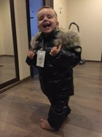 Wholesale 2016 new winter gilrs boys down clothing set kids rcccoon fur jacket overalls children brand suit with colors