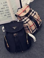 Wholesale Hot Han edition British female bag new grid shoulders female bag leisure pu backpack bag