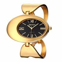 Las mujeres reloj de la marca a prueba de agua del estilo de Roma del óvalo dorado del ahueca hacia fuera la pulsera del brazalete de los relojes de manera señoras del vestido de pulsera
