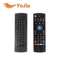 al por mayor tv remote control-Ratón de la mosca del aire 10pcs X8 MX3 2.4GHz Teclado sin hilos teledirigido IR de Somatosensory que aprende 6 ejes sin Mic para la caja androide de la TV