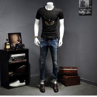 Wholesale Men s designer t shirts Little monsters eyes Business leisure brand shirts mens fashion hot drilling T shirt M XL