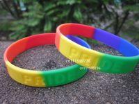 al por mayor pulseras del arco iris-50pcs / lot Pulsera pulsera de silicona Color del orgullo gay del arco iris flaco Relieve