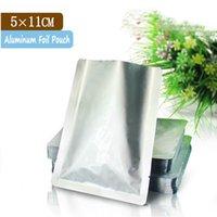 Precio de Bolsas de plástico para alimentos-100 bolsos de la bolsa de las PC Bolsos plásticos de la hoja del sello del calor de la hoja de aluminio 5x11cm / pequeños bolsos de plástico para los bolsos del alimento / de la bolsa del vacío plástico
