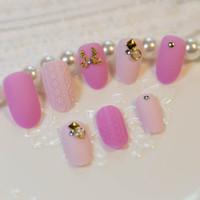 Wholesale Charming set Pink Stone Texture Sllipse Shape Short Fake Nail Full Cover Acrylic False Nails Set Kit Pink Black Silver nail art decora