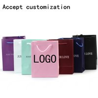Cheap custom logo printed paper packing shopping bags with handle,customized garment clothing gift packaging bag,party favor bag