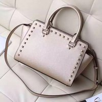 Wholesale The new button package fashion fashion leather handbag is definitely a very good package