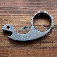 Wholesale Titanium TC4 Snail Design Mini Multi function Tool Bottle Openrer Knuckle Duster Tiger Finger Punch g pc