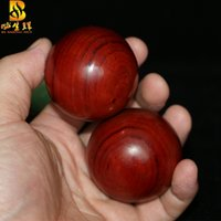 Wholesale health care ball rosewood rosewood handball hand pieces playing pieces of wood ball wooden hands grip the ball player