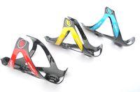 Precio de Carbono especial-Al por mayor-especiales se presentan como futuros para bicicletas botella titular de la botella de la jaula de carbono jaula de la bicicleta 2pcs 1lot mujeres de los hombres de la jaula jaula de envío libre