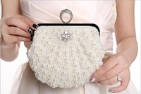 beaded phone accessories - 2016 New fashion pearl dinner banquet banquet black rice white champagne diagonal cross package life accessories leisure products