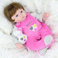 baby doll wigs - Soft Silicone Vinyl Dolls cm Doll Reborn Baby Brown Wig Girl Handmade Cotton Body Lifelike Bebe juguetes Babies Toys bonecas