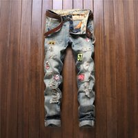 Wholesale New Arrival Mens American Style Patched Badge Jeans With Hole Ripped Destroyed Vintage Washed Frayed Blue Denim Jeans For Men