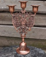Wholesale vintage retro copper cavalier embossed arm alloy metal candle holder stand candlesticks antique tin copper color