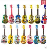 Wholesale High cost Andrew musical color cartoon Qinyoukeli in inch ukulele ukulele small guitar mini Complimentary spree