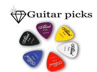 Wholesale 100pcs Single Thickness Guitar Picks ABS Smooth Mediator Plectrum Puas Guitarra Palheta Musical Instrument