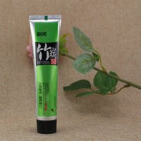 Wholesale Bamboo charcoal all purpose whitening the black toothpaste g Pure and fresh and green tea scent Free