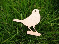 african log - a lovely bird on the log and visiting far away place wooden brooch
