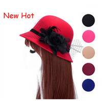Wholesale Fashion elegant feather wool hats winter Autumn England Jazz Top Hats woolen dome big eaves hat woman