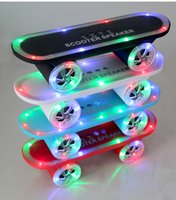 Wholesale Christmas Gift LED Flash Kick scooters Mini bluetooth speakers wireless Subwoofer Stereo Portable Skateboard speaker for Table pc phone