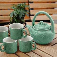 Wholesale bamboo handle teapot exquisite teapot ceramics teacup