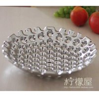 Wholesale Silver plated ceramic fruit plate hollowed out fruit bowl of modern high end European fashion creative decoration room decoration