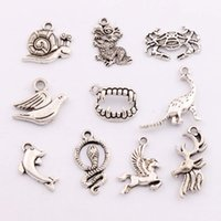 antique dolphins - 200PCS styles Antique Silver Dinosaur Dragon Snake Horse Crab Dolphin Spacer Charm Beads Pendants Alloy Handmade Jewelry DIY LM4