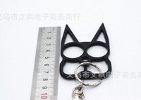 Wholesale Hot sell Justice cat creative double finger knuckles buckle hidden weapon self defense defense key chain can be used as escape Supplies