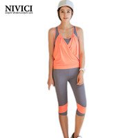 Wholesale NIVICI Sexy women yoga New tracksuit for women Capris leggings Female costume Workout sleeveless shirt Elastic sport suit