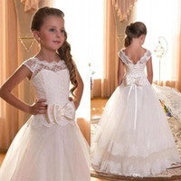 Wholesale 2016 Cheap In Stock Flower Girl Dresses Sheer Jewel Neck Cap Sleeves Lace up Back with Big Bow Sash Girl Formal Party Wear CPS292