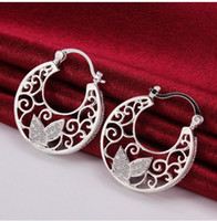 Wholesale fashion jewelry sterling silver earrings beautifully carved round two kinds of color