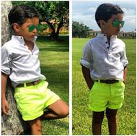 al por mayor los pantalones vaqueros de color amarillo para los niños-Al por mayor-bebé de la ropa del Camiseta blanca y amarilla ponen en cortocircuito para el verano de la manera del dril de algodón Pantalones Pantalones cortos para niños pequeños teans