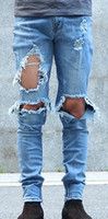 Wholesale kpop skinny ripped korean hip hop fashion pants cool mens urban clothing jumpsuit men s jeans kanye west slp fear of god