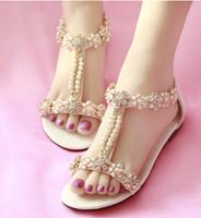 Precio de Sandalias de perlas flores-Cristal flor perla plana Zapatos de Cowskin zapatos de boda de playa Sandalias nupcial Zapatos Sandalias Mujer Sandalias de playa de vacaciones de verano 34--40