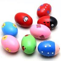 Wholesale Children Sand Eggs Instruments Percussion Musical Toys Random Color A00123