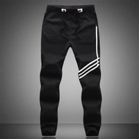 Wholesale New Spring men s Fashion Designer Trousers Sweatpants Men Casual Pants Slim Pencil Pants Stripe Joggers M XL
