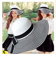 beach wind shade - 2016 brand new The sun hat Big bowknot eaves shading Hepburn wind black and white stripe hat children spring and summer beach hat