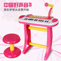 Wholesale Children electronic organ with a microphone and a small multifunctional baby girl Toy Puzzle early piano music