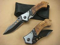 Wholesale Browning eyes Survival folding knife C HRC Black oxide finish blade Wood handle knife Outdoor survival knife