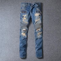 Wholesale Europe and the new Balmain jeans big patch of embroidery hole Slim Washed blue jeans feet jeans fashion locomotive