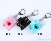 Wholesale new yellow keychain mini digital single lens reflex SLR camera style LED flash light