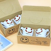 Wholesale 1 sets of high temperature resistant Smiling face couples ceramic cup spoon with packaging