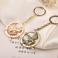 bag hunger - fashion popular design round metal The Hunger Games Mockingjay key chain two colors option for bags decoration