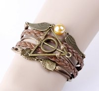 Wholesale Silver Bracelet Hand Pendant - European and American original single retro jewelry bronze Harry Potter and the Deathly Hallows wings hand-woven bracelet wholesale 300