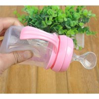 Wholesale 2 Colors Infant Silica Gel Baby Feeding Bottle With Spoon Food Supplement Rice Cereal cheap Bottle