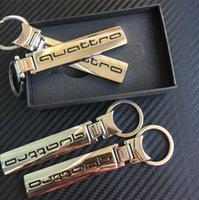 al por mayor logotipo de quattro-Logotipos de calidad superior de la mezcla CAJA DE REGALO 10setS aleación quattro llaveros cromo del anillo dominante del coche