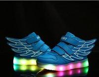 Zapatos de las muchachas Zapatillas de deporte de la manera 2016 Zapatos de los niños que brillan intensamente del rodillo con las ruedas Niños que llevaron se encienden para arriba Zapatos de los zapatos del ala Tamaño 21-30 TX4
