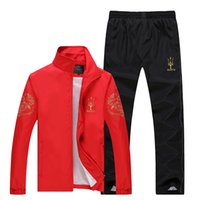 Wholesale Men s Spring and Autumn outdoor jogging Breathable sport suit movement Two piece Loose Large size Men s Running Sets
