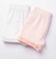 Розовые ноги Цены-Летние девушки Кружева оборка Хлопок Леггинсы детей шнурок безопасности шорты Принцесса Купированные брюки платье Ноги износа леггинсы T1027 розовый белый