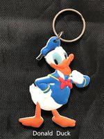 al por mayor colgante de pato donald-Cartoon Donald Duck encanto colgantes de goma de dos lados moda llavero joyería haciendo accesorios colgante